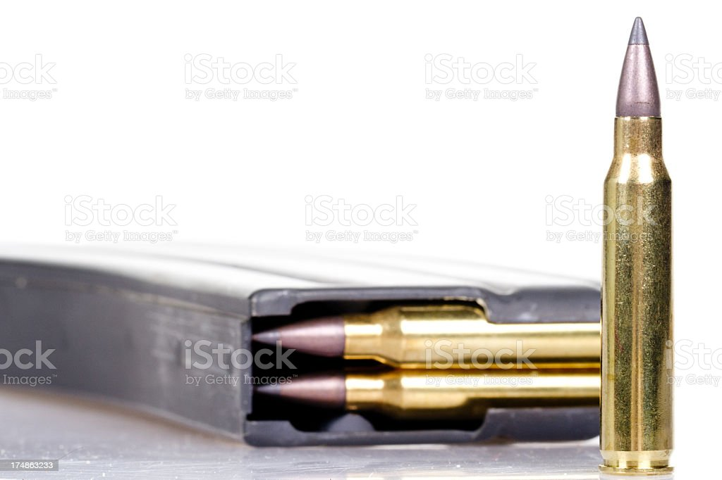 A bullet outside a high capacity magazine stock photo
