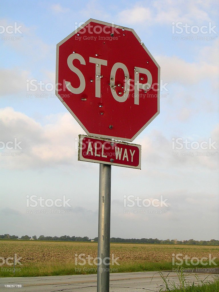 Bullet Riddled Stop Sign royalty-free stock photo
