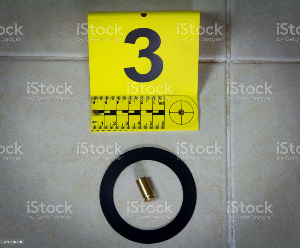 A bullet shell found on the floor stock photo