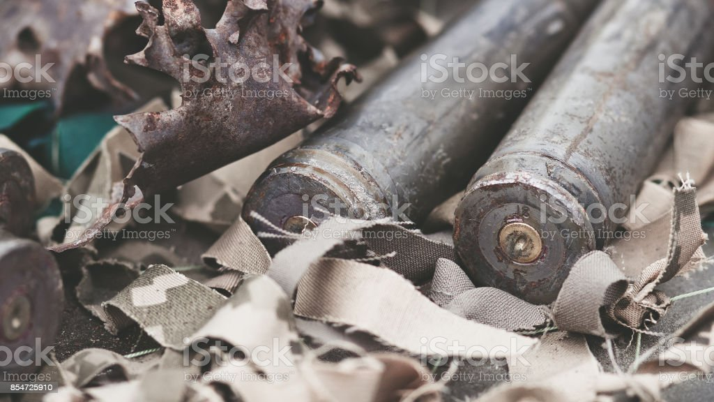 bullet shells from heavy machine gun on the table with camouflage netting stock photo