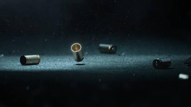 kogel schelpen grond. gevallen van kogels liggend op de vloer van asfalt-3d renderen - gun shooting stockfoto's en -beelden