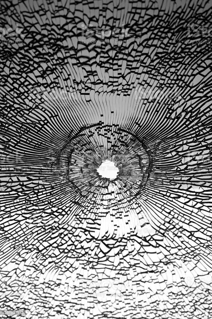 Bullet shot on broken window stock photo