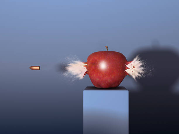 Bullet through an apple stock photo