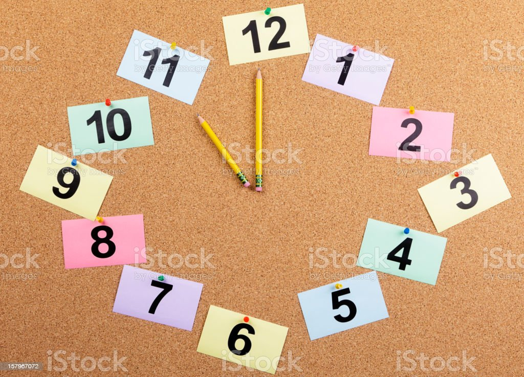 Bulletin Board Clock Displaying 11:00 royalty-free stock photo