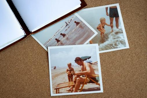 Bulletin board with 1970s family photos at beach