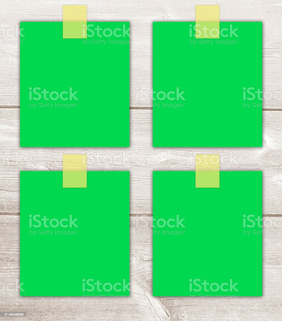 Bulletin Board With Four Green Blank Stickers Stock Photo
