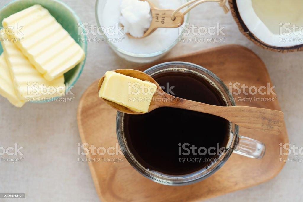 bulletproof coffee, blended with organic grass fed butter and MCT coconut oil, paleo, keto, ketogenic drink breakfast stock photo