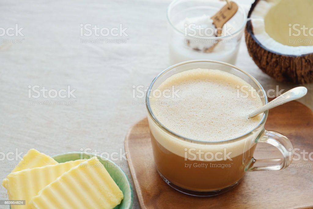 bulletproof coffee latte, blended with organic grass fed butter and MCT coconut oil, paleo, keto, ketogenic drink breakfast stock photo