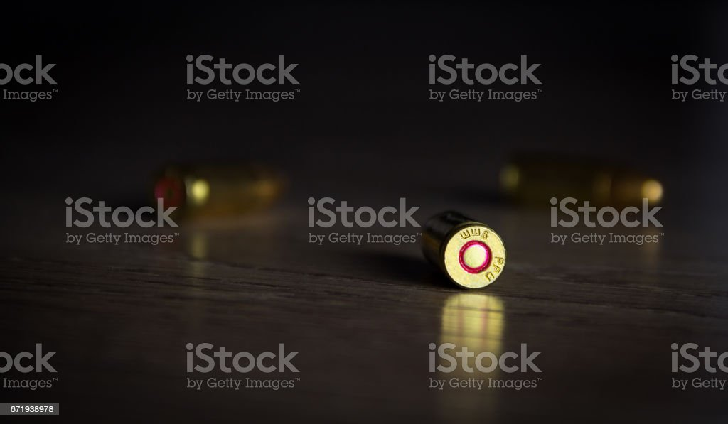 Bullets in shadow on floor stock photo