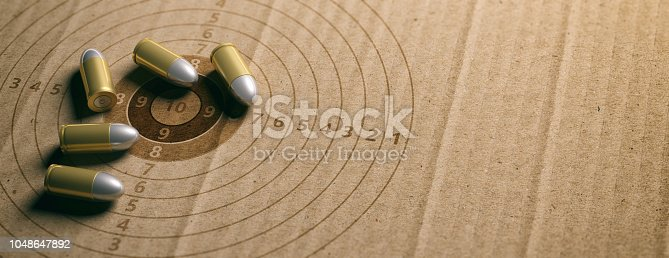 1048647890 istock photo Bullets on shooting target, recycling carton paper, banner, copy space. 3d illustration 1048647892