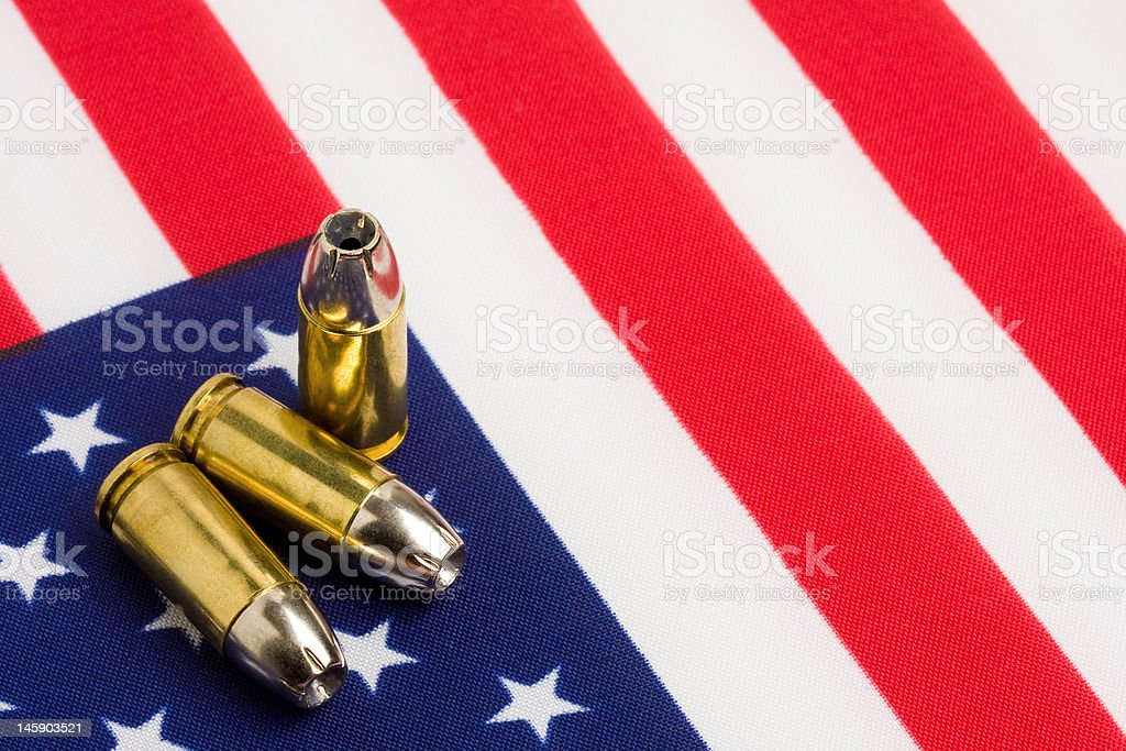 bullets over US flag stock photo