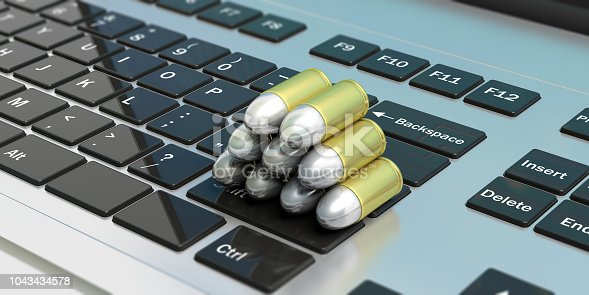 istock Bullets stack isolated on computer keyboard. 3d illustartion 1043434578