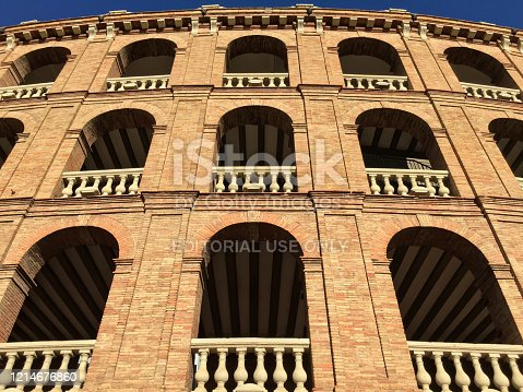 Valencia, Spain - March 4, 2020: Low angle view of the bullfight ring in the city downtown. It was built between 1850 and 1859 in the neoclassical style, inspired by civil Roman architecture such as the Colosseum in Rome or the Arena of Nîmes in France