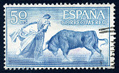A 50 Centimos Spanish air mail postage stamp issued in 1960 depicting a bullfight.