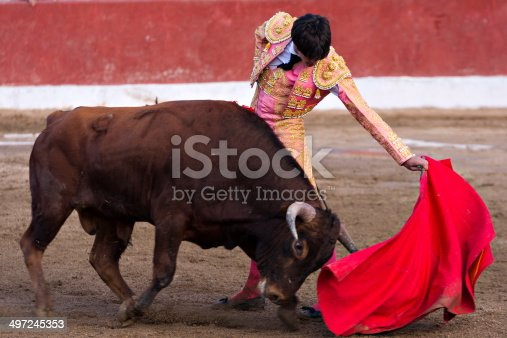 Bullfighter and bull in action. Spain