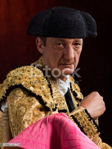 Portrait of an old bullfighter wearing the typical dress