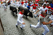 Pamplona, Spain - July 10, 2017: Bulls and people running on the street during the festival of San Fermin. Bulls of the cattle ranch of Fuente Ymbro in the fourth run of the festival of San Fermin