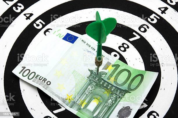Bulls eye hit 100 euros Hit into bulls eye with 100 euros bank note / business concept Accuracy Stock Photo