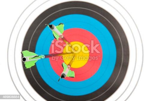 istock Bull's eye hit by three arrows 469806654