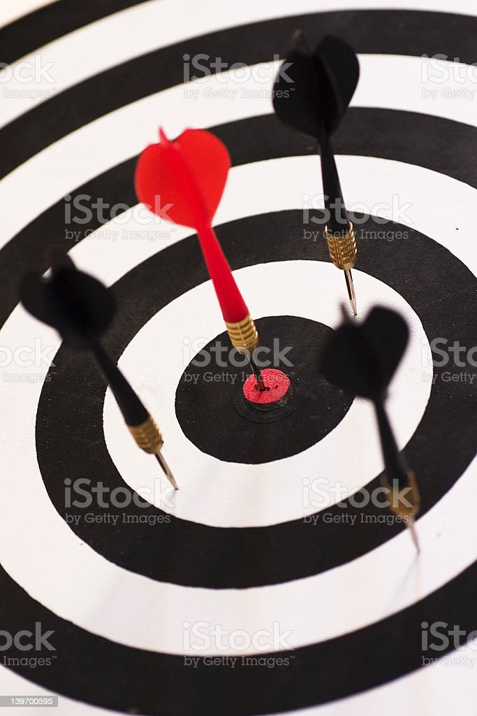 The red dart smack in the center of the board symbolizing perfection