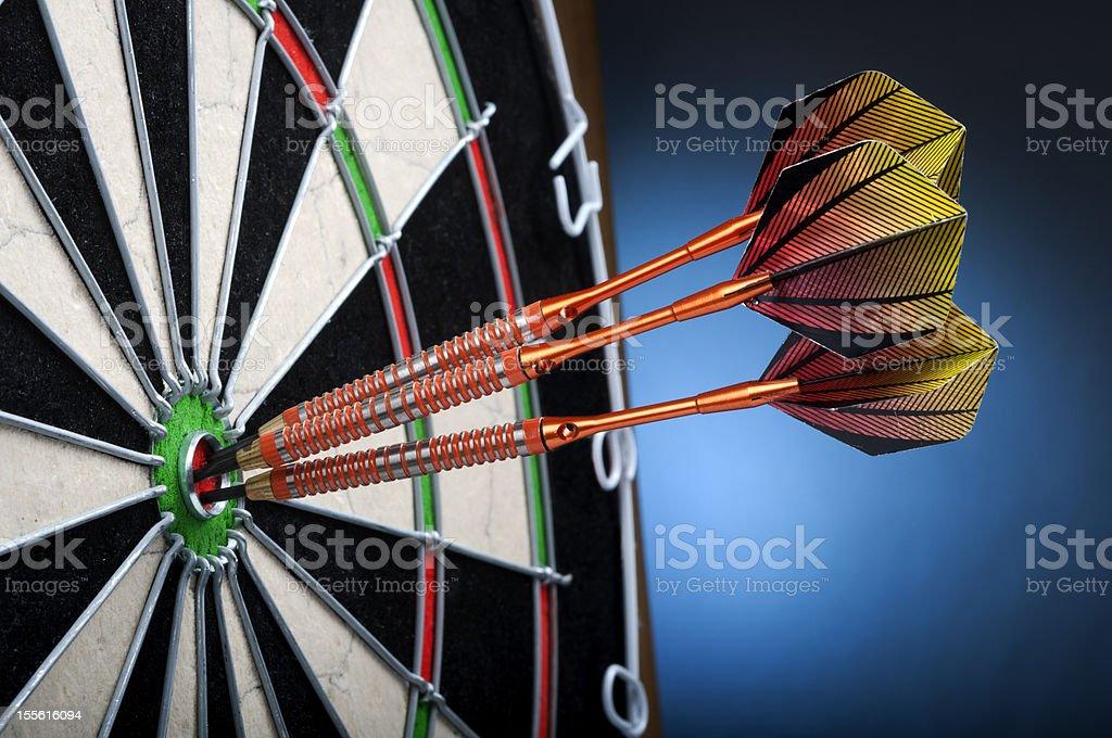 Three darts in the Bulls-Eye.