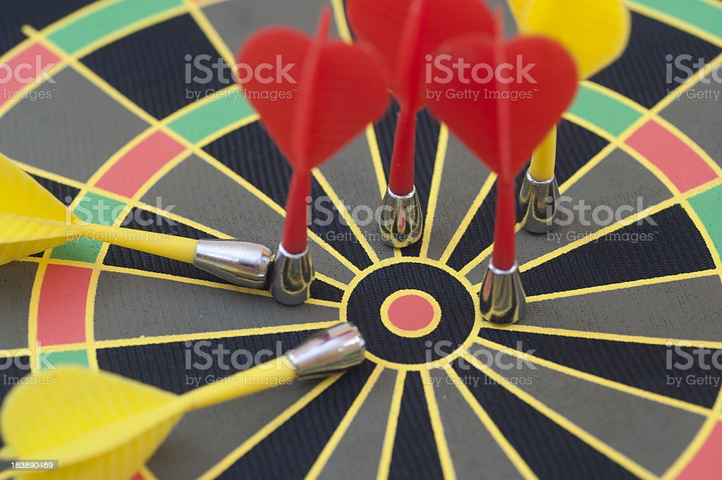 bulls eye with many darts royalty-free stock photo