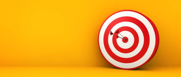 bullseye on yellow background stock photo
