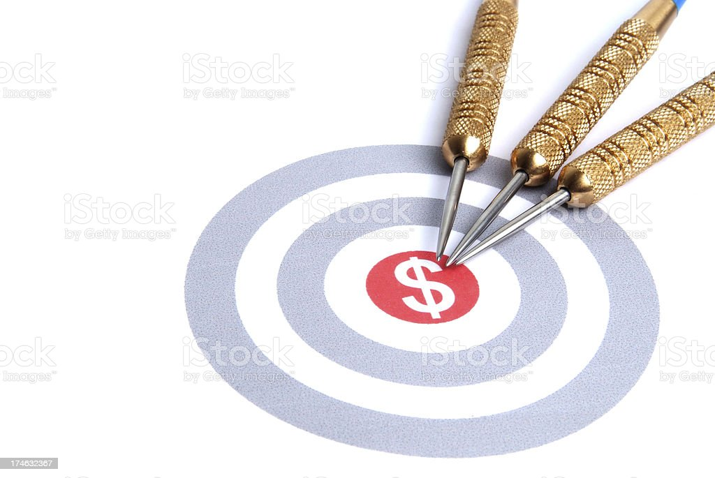 Bullseye with dollar sign and gold darts pointing to middle. royalty-free stock photo