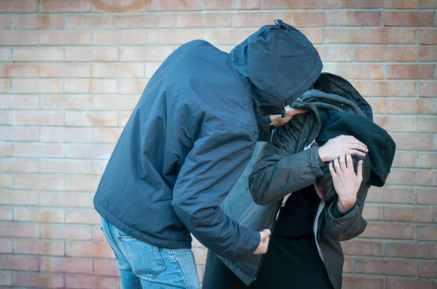Bullying, aggression and violence scene between two young adult males Bullying, aggression and violence scene between two males, one young adult male punches his peer near a bricks wall aggression stock pictures, royalty-free photos & images