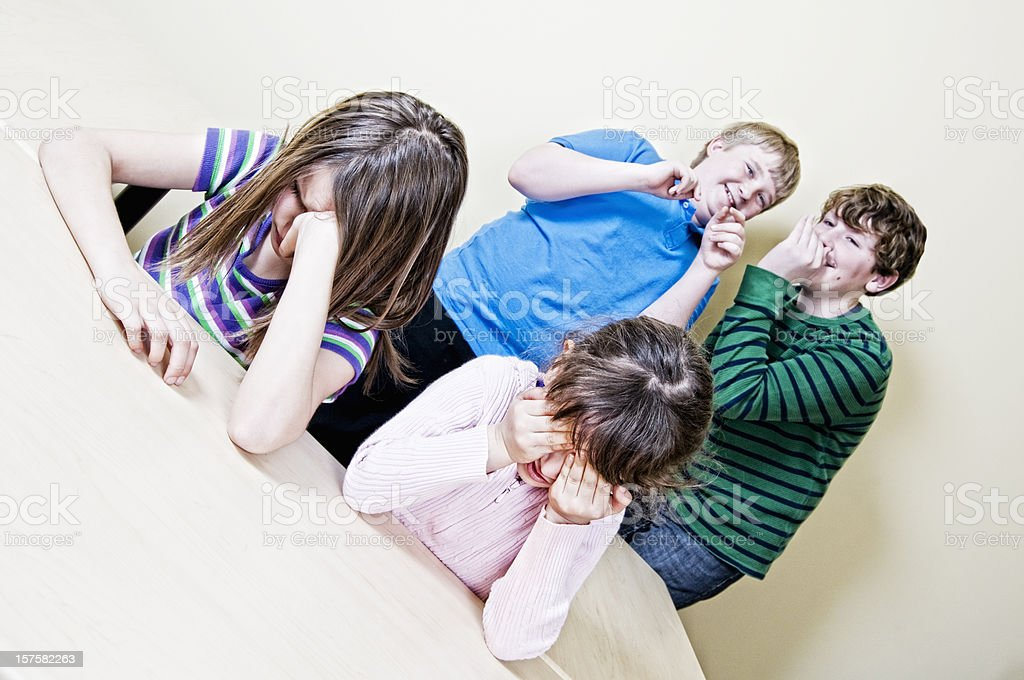 Bullying Concept, Mean Kids in a Classroom royalty-free stock photo