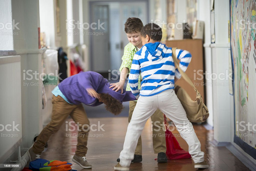 Bullying In The School Corridor stock photo