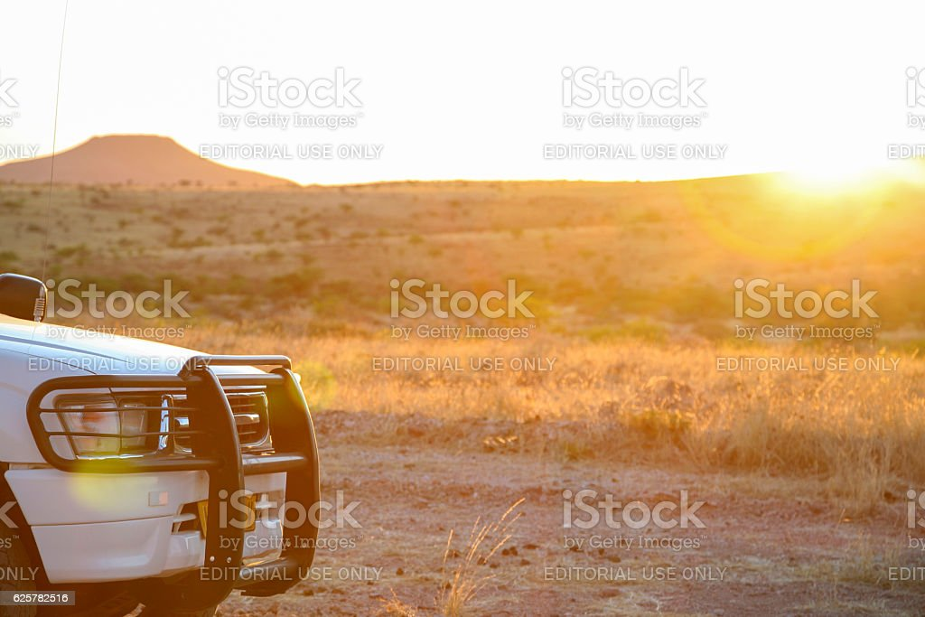 Bumper from 4x4 SUV with mountain and sunset stock photo