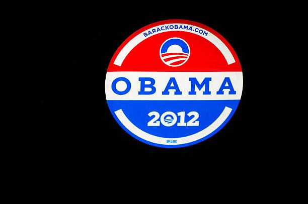 OBAMA 2012 Bumper Sticker on Black Car (Close-Up) stock photo