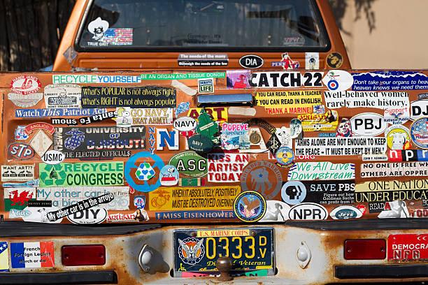 Bumper Stickers Galore: Back of Veteran's Rusty Pickup Truck stock photo