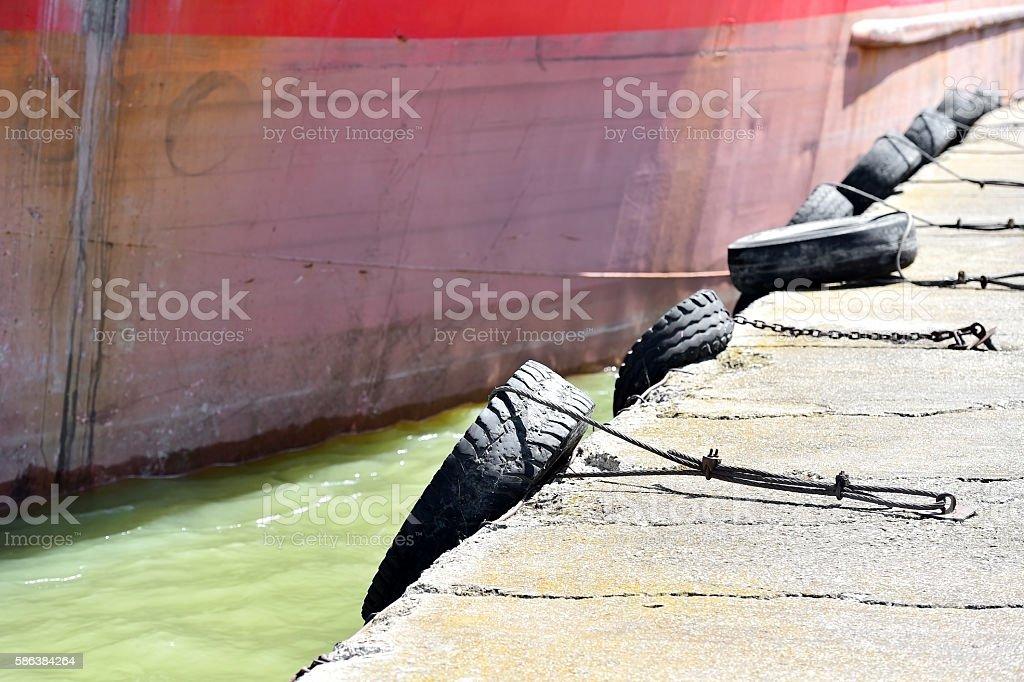 Bumper tyres on a pier stock photo