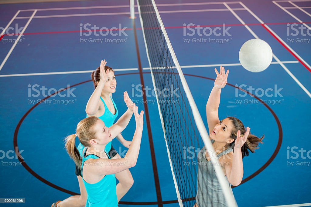Bumping the Ball Over the Net stock photo
