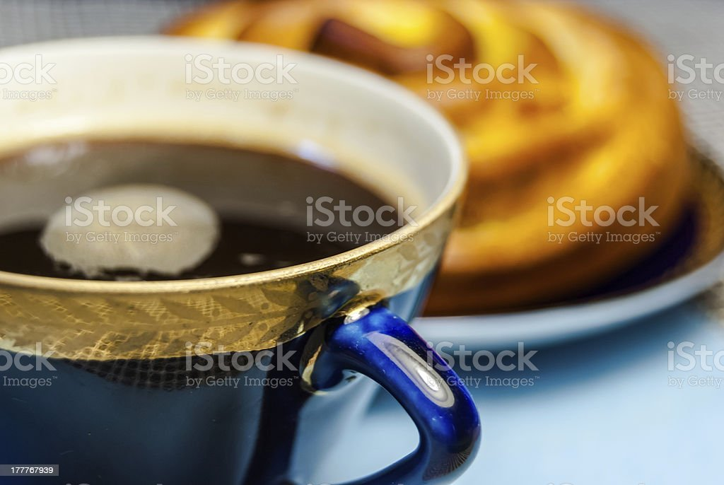 bun and coffee on a table royalty-free stock photo