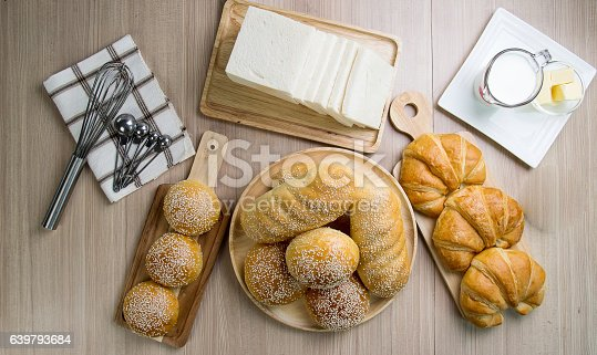 istock Bun breads and milk with kitchen equipment 639793684
