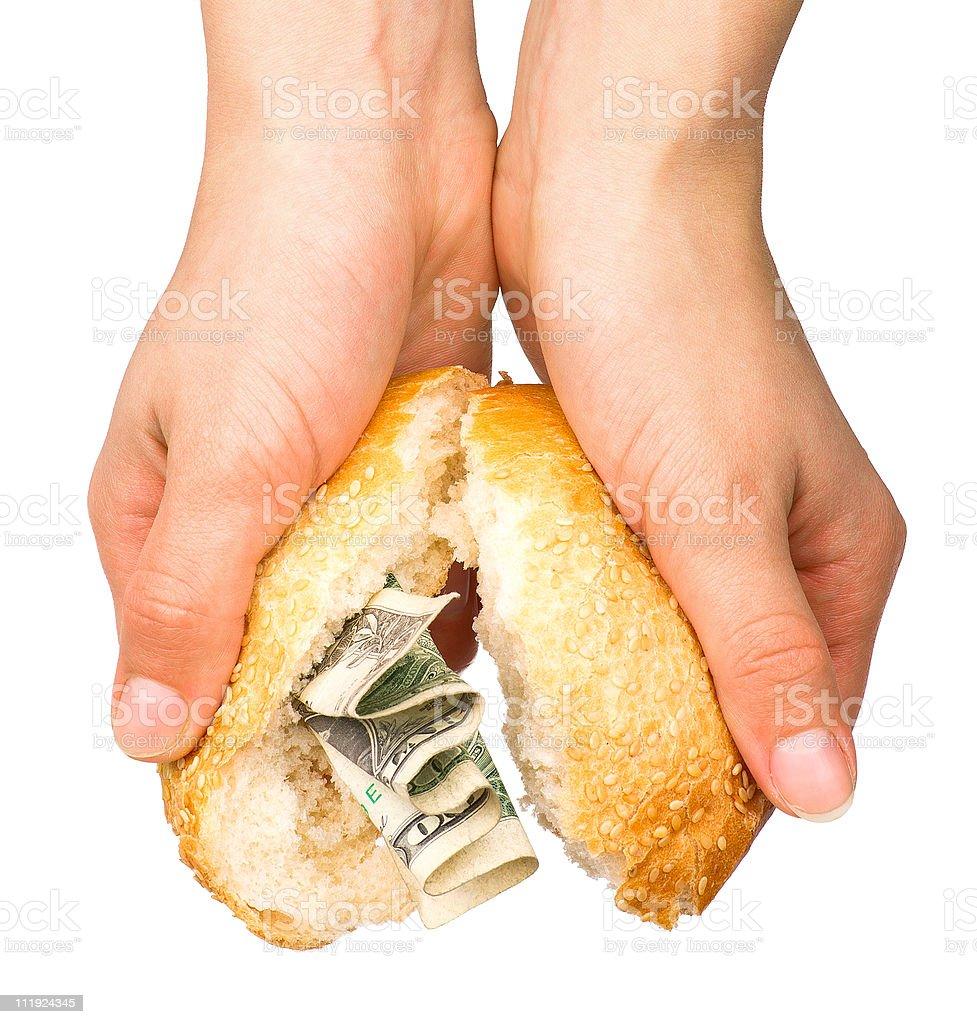 Bun stuffed with money stock photo