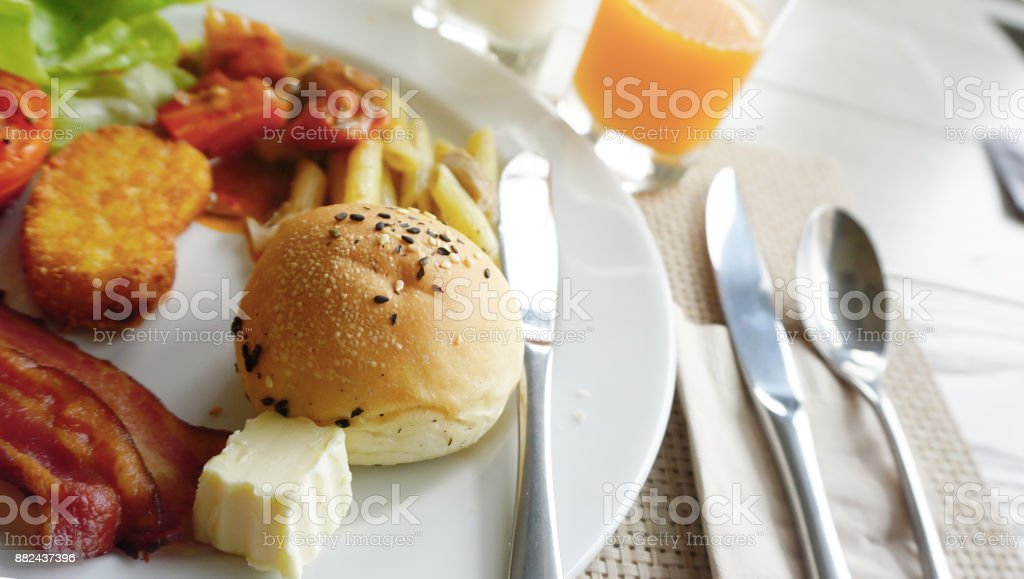 Bun with sesame seeds arranged in breakfast dish stock photo