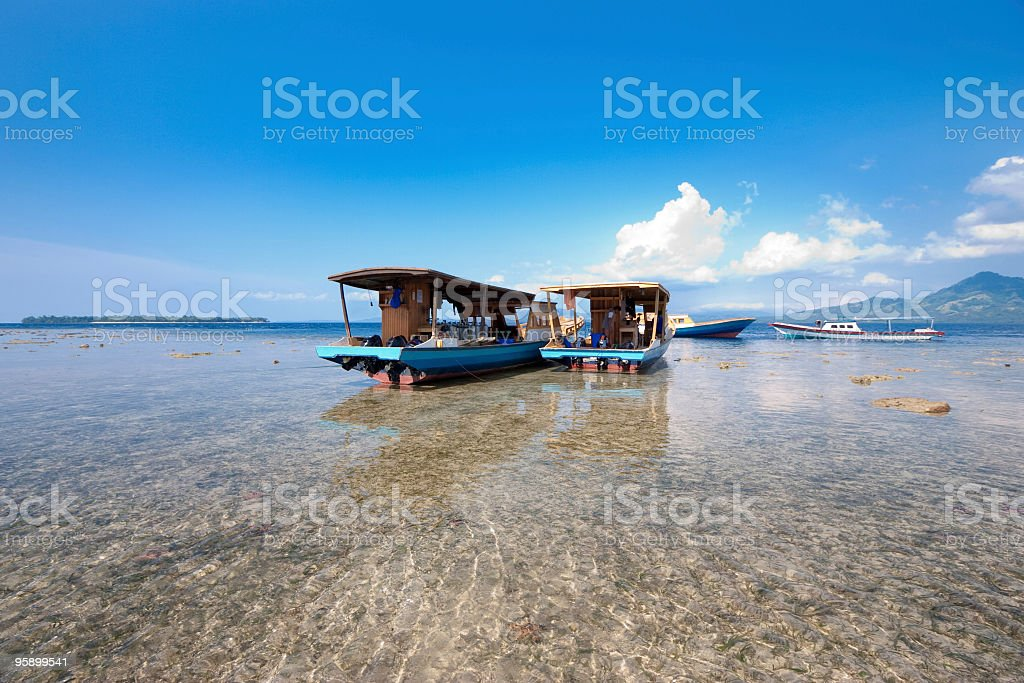 Bunaken Island: Boats at Low Tide, waiting for Next Dive stock photo
