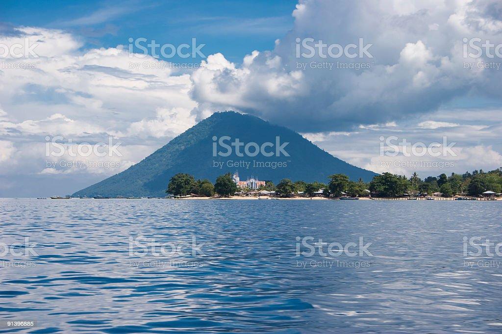 Bunaken village with Manado Tua, National Marine Park, Indonesia stock photo