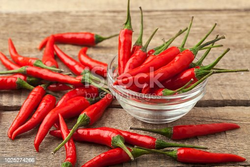 bunch fresh raw red hot chilli pepper on a wooden background tie
