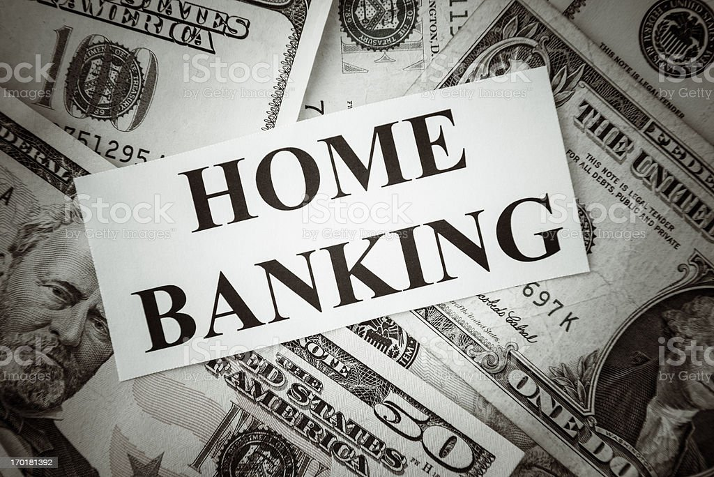 Bunch of American dollars with home banking text royalty-free stock photo