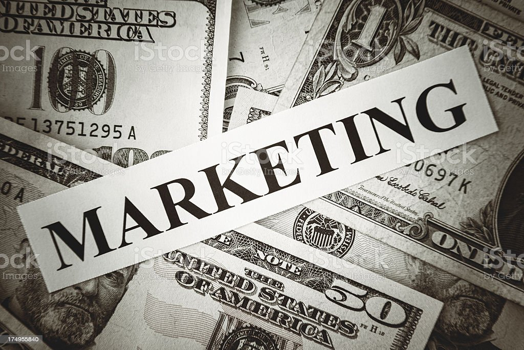 Bunch of American dollars with marketing text royalty-free stock photo