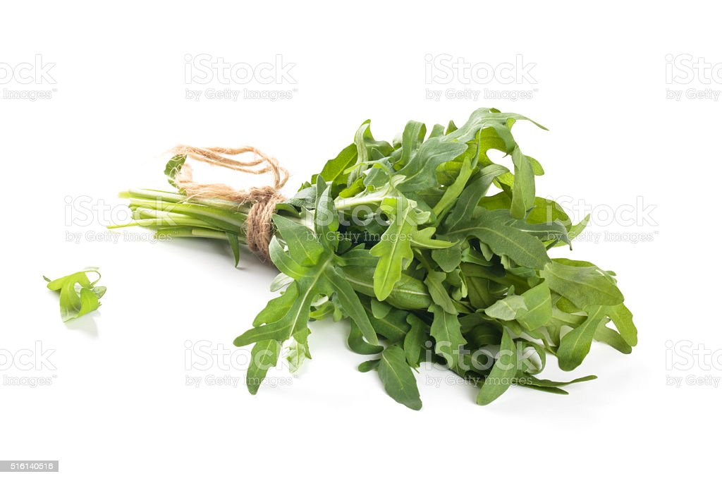 Bunch of arugula leaves. stock photo