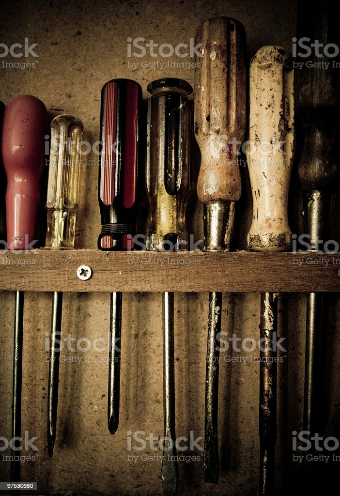 Bunch of assorted Screwdrivers in old tool shed royalty-free stock photo