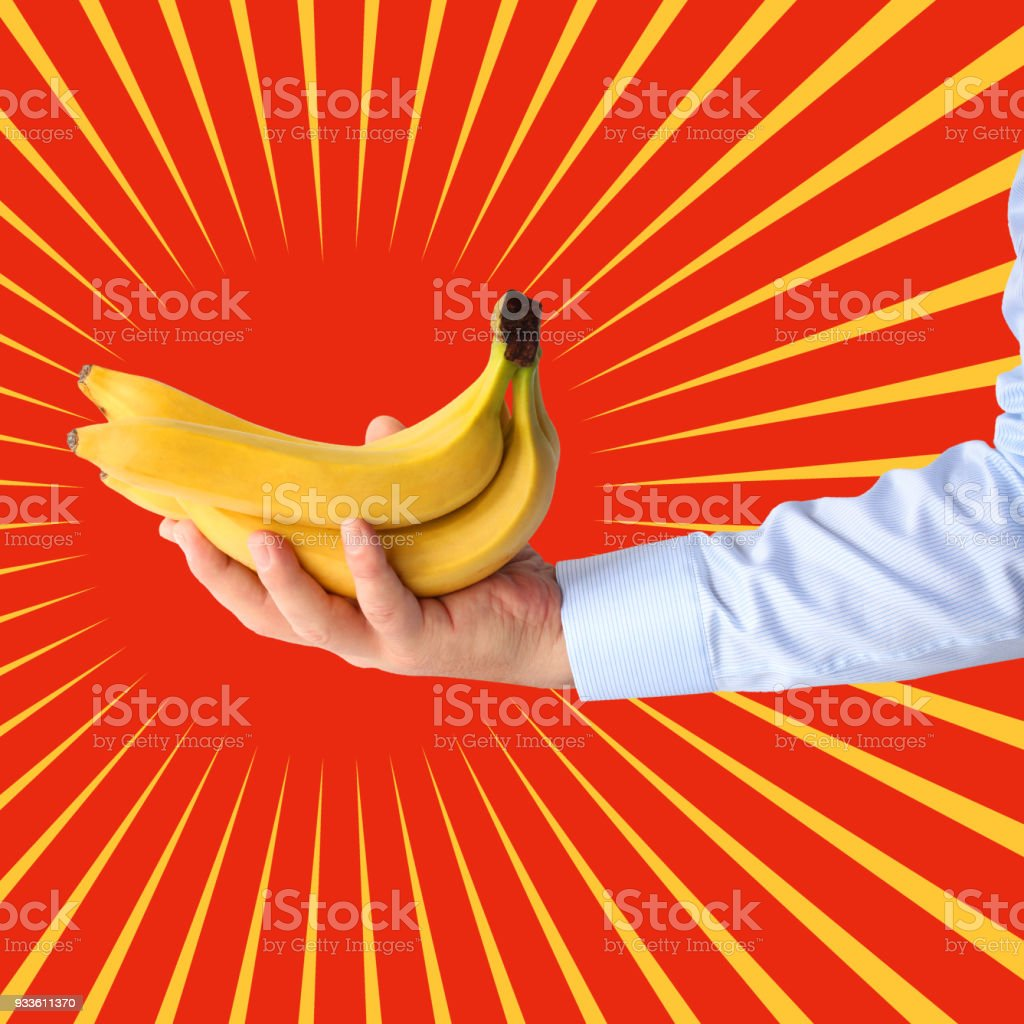 Bunch of bananas  in hand on stylized background of sun. Pop art stock photo