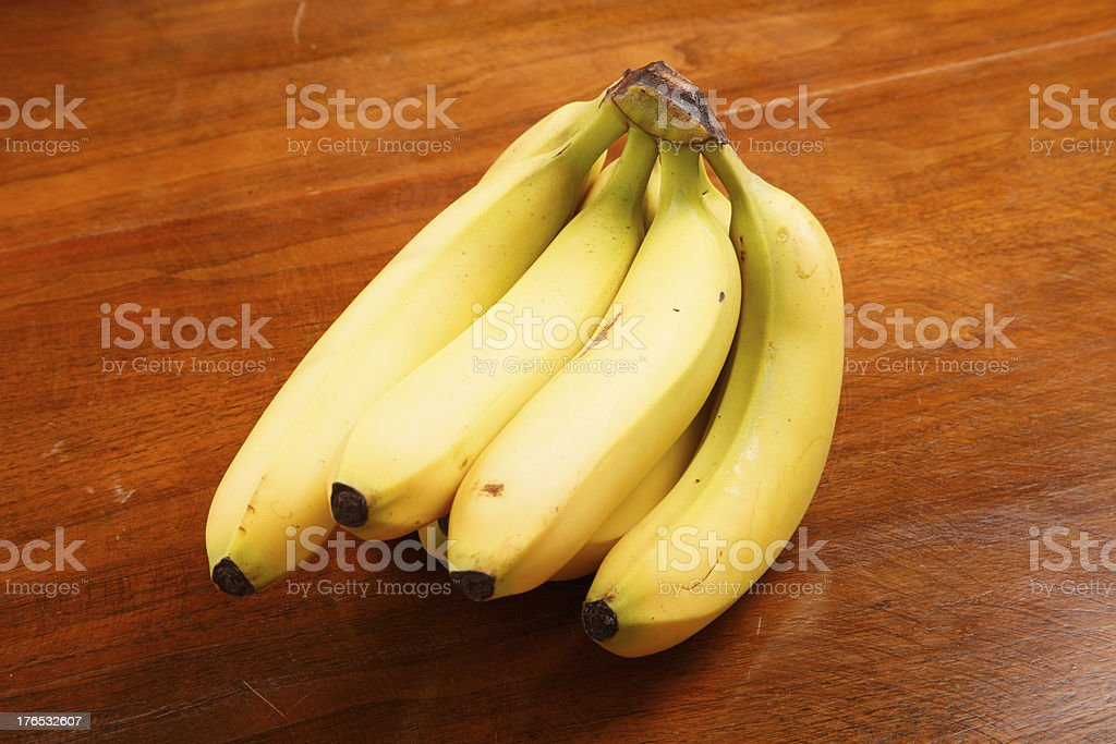 Bunch of Bananas on a Wood Table royalty-free stock photo