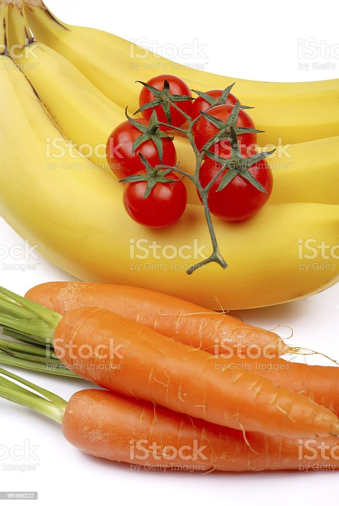 Bunch of bananas, tomatoes and carrot royalty-free stock photo